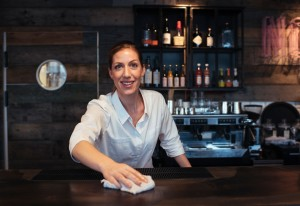 Young woman working in a restaurant bar